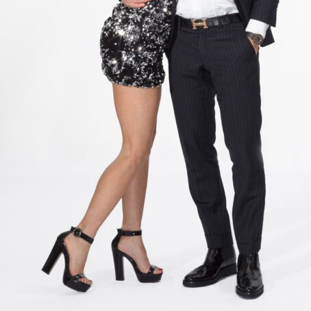 man and woman wearing elegant shoes