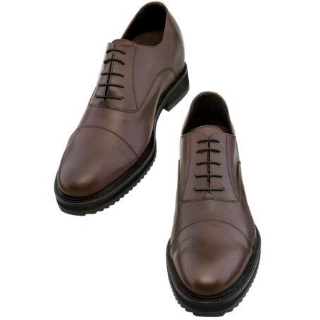 scarpe in pelle fatte a mano con tacco rialzato