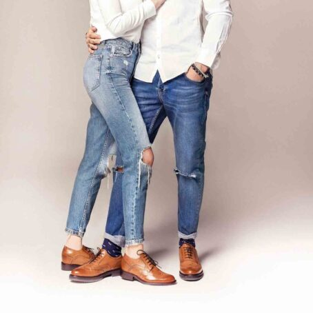 couple wearing brogue brown dress shoes