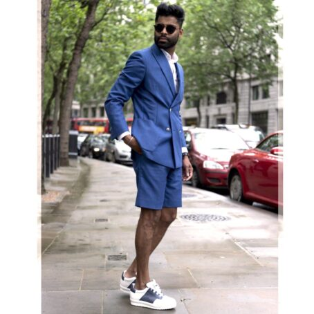 tall man wearing white and bluea sneakers