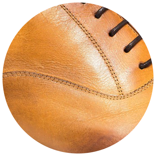 detail of yellow brown leather shoe - Guidomaggi Switzerland