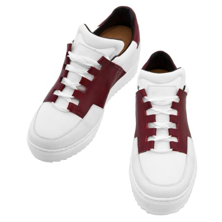 Man wearing white and red elevator sneakers 2