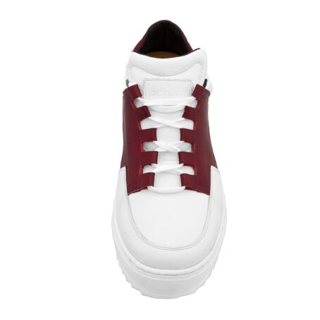 Man wearing white and red elevator sneakers 4