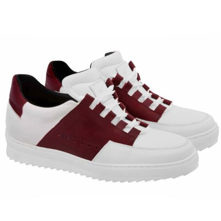 Man wearing white and red elevator sneakers 5