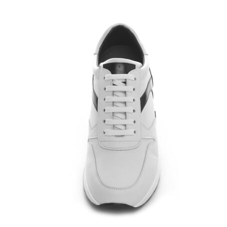 white sneakers with black shiny details on back 4