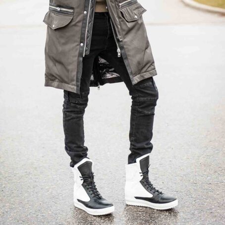 man walks in his black and white mid-cut sneakers