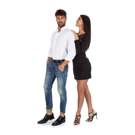 couple with man wearing classic shiny black derby shoes with brogue decorations