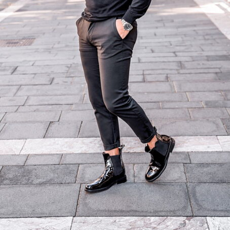man wearing black patent chelsea boots