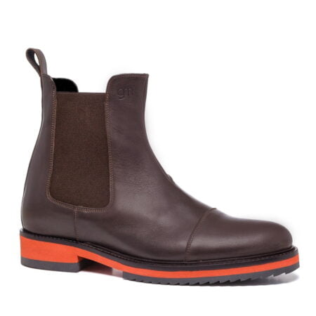 brown chelsea boots with orange outsole