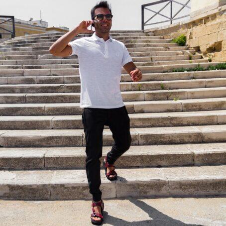 Man wearing dark pupms sneakers 2