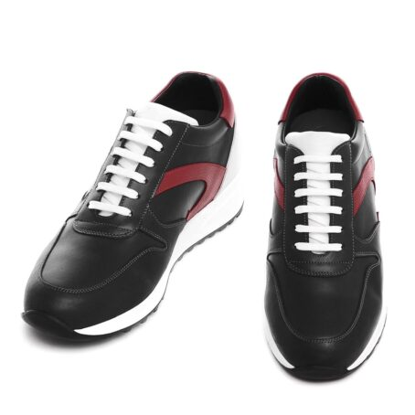 black sneakers with red leather details 2