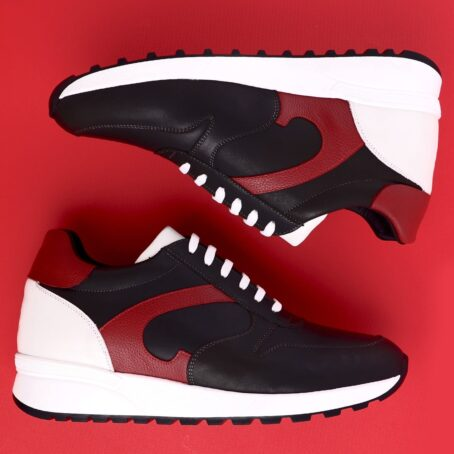 black sneakers with red leather details 6