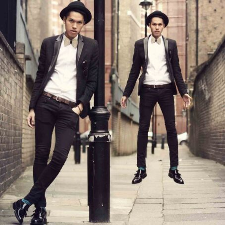 man wearing double monk strap shoes in black patent leather