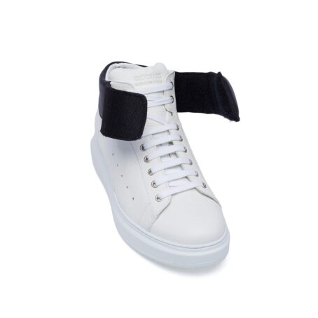 white sneakers with black stripe 5