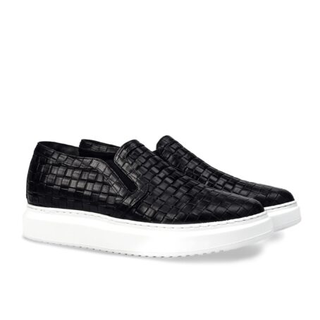 textured black slip-ons with white outsole 5