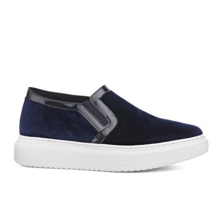 blue velvet slip-ons with black patent finishing
