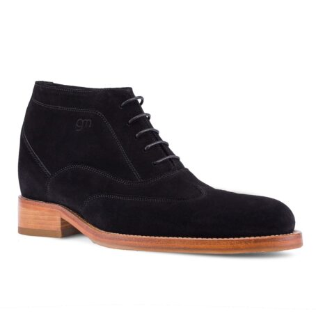 black suede chukka ankle boots with brown outsole 1