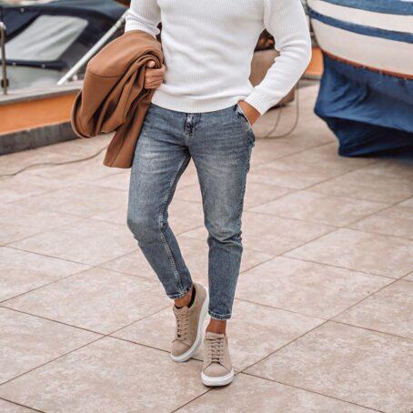 Man wearing beige sand sneakers