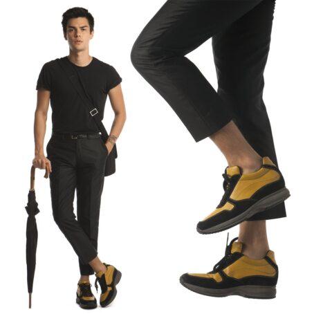 Man wearing mustard elevator sneakers